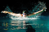 Trinity High School swimmer practices her butterfly stroke before the start of the season.
