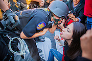 20 MARCH 2012 - PHOENIX, AZ: Phoenix police warn a student she will be arrested for blocking the road during a student protest in support of the DREAM Act on 75th Ave in front of Trevor G. Browne High School Tuesday. She was arrested shortly a few minutes later.   PHOTO BY JACK KURTZ
