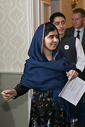 © Licensed to London News Pictures. 15/12/2015. Birmingham, UK. Malala Reception. Pictured, Malala Yousafzai enteres the room followed by Ahmad Nawaz. One year on from the tragedy of the Taliban attack on the Army Public School (APS) Peshawar, Nobel Prize winner and teenage activist, Malala Yousafzai and her family hosted a special reception to mark the anniversary of one of the deadliest terrorist attacks in Pakistan.The commemorative reception held today was attended by Ahmad Nawaz and Muhammad Ibrahim Khan, two of the young survivors of the tragedy, along with Malala Yousafzai, the peace and education activist, who has made Birmingham her adopted home. As part of the commemorative ceremony, members of the public are being asked to wear a white poppy, representing the global mark of peace. Photo credit : Dave Warren/LNP