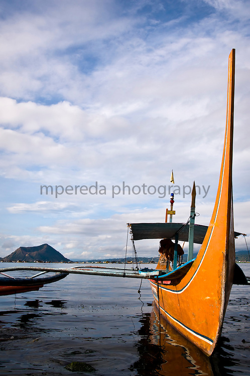 LAKE TAAL (Philippines). 2009. A boat on Lake Taal with a crater of Taal volcano in the background