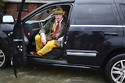 © Licensed to London News Pictures. 11/02/2014. Shepperton and Chertsey, UK. NIGEL FARAGE, leader of UKIP, walks along Chertsey Bridge Road. Flooding in SHEPPERTON AND CHERTSEY in Surrey today 11th February 2014 after the River Thames burst its banks. The Environment Agency has issued 14 Severe Flood Warnings alone the Thames. Photo credit : Stephen Simpson/LNP