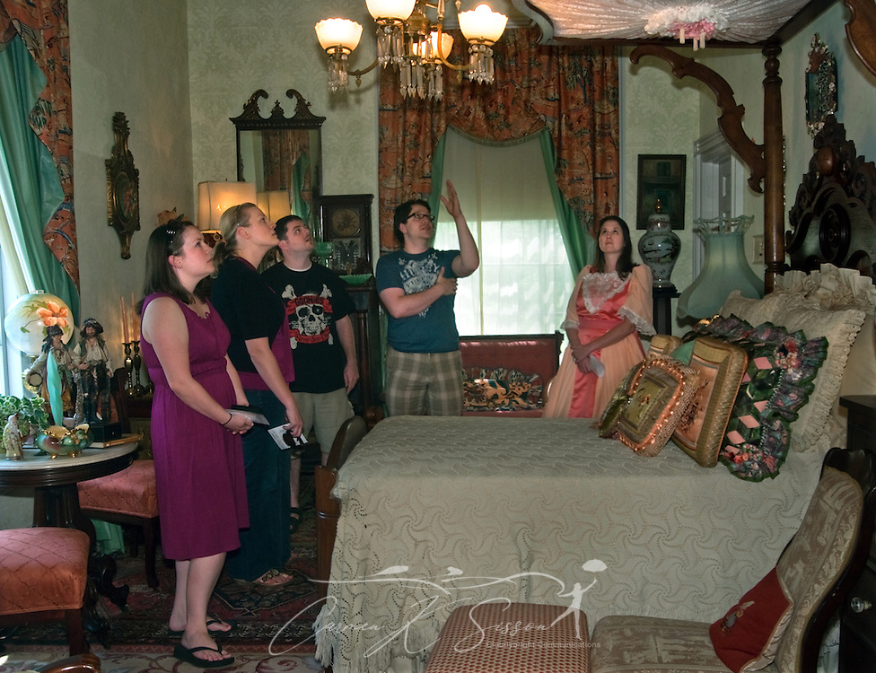 Visitors examine an antique half-tester bed at Rosewood Manor in Columbus, Miss. April 16, 2010. The 1835 Greek-Revival antebellum mansion was among nearly two dozen on tour during Columbus' annual Spring Pilgrimage. (Photo by Carmen K. Sisson/Cloudybright)