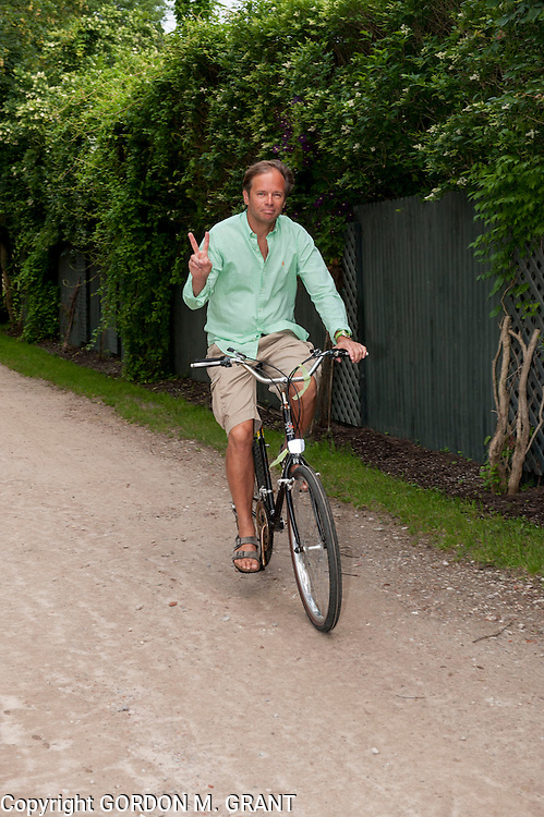 Kevin Roberts from Huntington wears a mint Polo shirt and Levi's shorts to the 2nd annual benefit cocktail party for the Stony Hills Stable Foundation in Amagansett. (June 29, 2013)  <br /> Photo by Gordon M. Grant