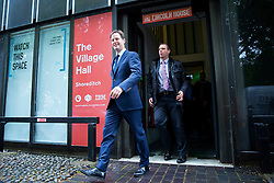 © Licensed to London News Pictures. 28/05/2014. LONDON, UK. Deputy Prime Minister Nick Clegg leaving The Village Hall in Hoxton Square, London on Wednesday, 28 May 2014 after giving a speech on International Development. Photo credit : Tolga Akmen/LNP