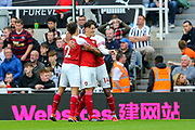 Mesut Ozil (#10) of Arsenal celebrates Arsenal's second goal (0-2) during the Premier League match between Newcastle United and Arsenal at St. James's Park, Newcastle, England on 15 September 2018.