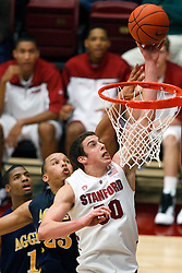 December 15, 2010; Stanford, CA, USA;  Stanford Cardinal forward/center Jack Trotter (50) shoots past North Carolina A&T Aggies forward/center Thomas Coleman (23) during the second half at Maples Pavilion.  Stanford defeated North Carolina A&T 76-59.