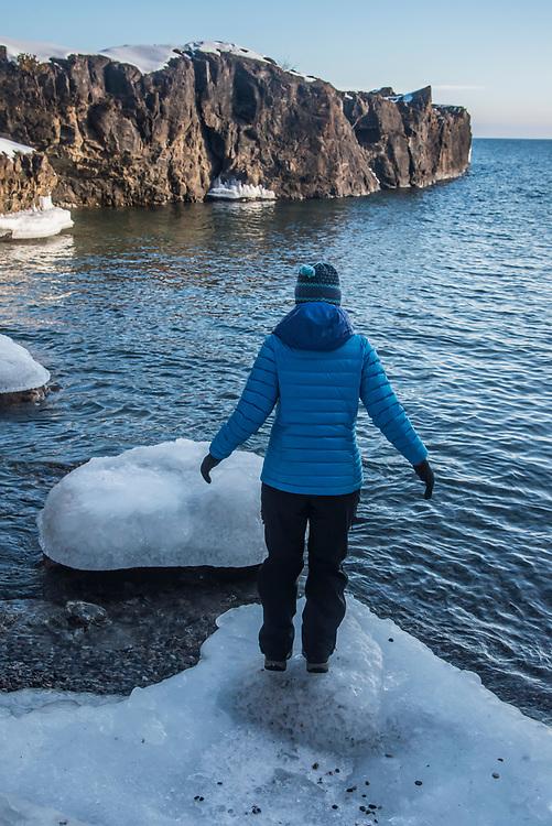 Lake Superior shoreline in winter at Presque Isle Park in Marquette, Michigan.