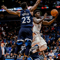 Nov 1, 2017; New Orleans, LA, USA; New Orleans Pelicans guard Jrue Holiday (11) shoots over Minnesota Timberwolves guard Jimmy Butler (23) during the second half of a game at the Smoothie King Center. The Timberwolves defeated the Pelicans 104-98. Mandatory Credit: Derick E. Hingle-USA TODAY Sports