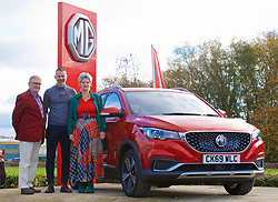 BRIDGEND, WALES - Tuesday, November 5, 2019: Wales manager Ryan Giggs (C) hands over the keys of an MG ZS electric vehicle to the first owners in Wales, Joe and Anne Chester before a press conference at Nathaniel Cars in Bridgend to announce his squad for the final UEFA Euro 2020 Qualifying Group E qualifying matches against Azerbaijan and Hungary. (Pic by David Rawcliffe/Propaganda)
