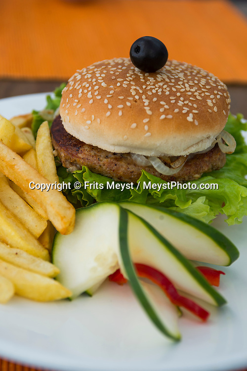 Tavira, Algarve, Portugal, October 2014. Octopus Burger. The Old town centre of Tavira. A spectacular coastline of steep sandstone cliffs borders hidden sandy beaches on the south western tip of Europe, where the Mediterranean becomes the Atlantic Ocean.  Photo by Frits Meyst / MeystPhoto.com