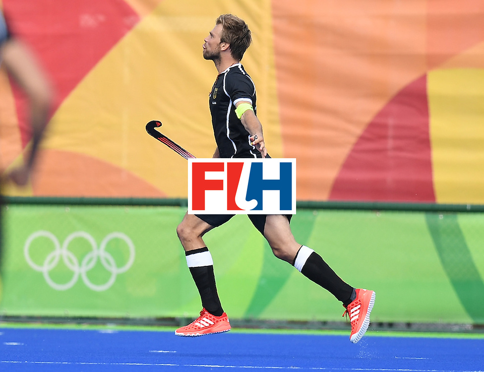 Germany's Moritz Furste celebrates scoring a goal during the men's field hockey Germany vs Ireland match of the Rio 2016 Olympics Games at the Olympic Hockey Centre in Rio de Janeiro on August, 9 2016. / AFP / MANAN VATSYAYANA        (Photo credit should read MANAN VATSYAYANA/AFP/Getty Images)