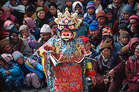 A medium dances in full costume during the Matho Temple festival in Ladakh, India