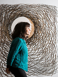 A Fine Line is a group exhibition exploring the fine line between art and craft in two and three dimensions and opens at Edinburgh's City Art Centre on Saturday 18 November 2017 until 18 February 2018.<br />  <br /> A Fine Line features work by four contemporary artists based in Scotland - Lizzie Farey, Angie Lewin, Frances Priest and Bronwen Sleigh, bringing together a diverse range of disciplines including printmaking, drawing, collage, sculpture and ceramics.<br /> <br /> Pictured: Lizzie Farey with her willow sculpture, My Mother's Garden III
