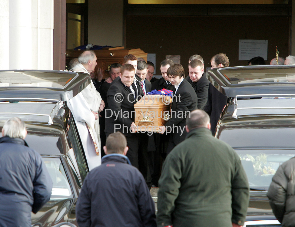 15/12/2005.The coffins of David and Michael Harris beingh taken from the church at their funeral in Athy County Kildare yesterday.
