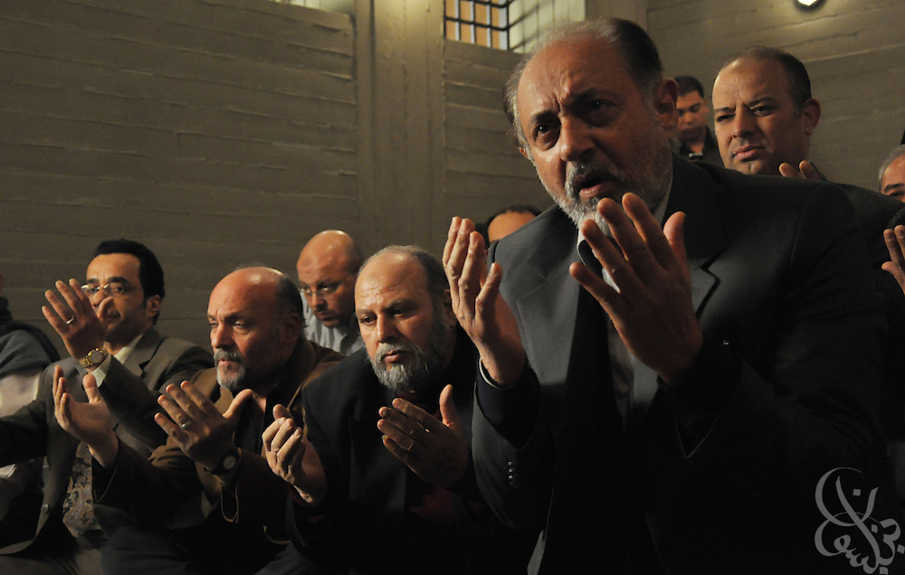 "Fictional members of the Muslim Brotherhood pray together in a scene from the Egyptian television Ramadan miniseries entitled ""Al Gama'a"". The controversial series is based on the formation and history of the Muslim Brotherhood in Egypt and was written by famed Egyptian screen writer Waheed Hamid."