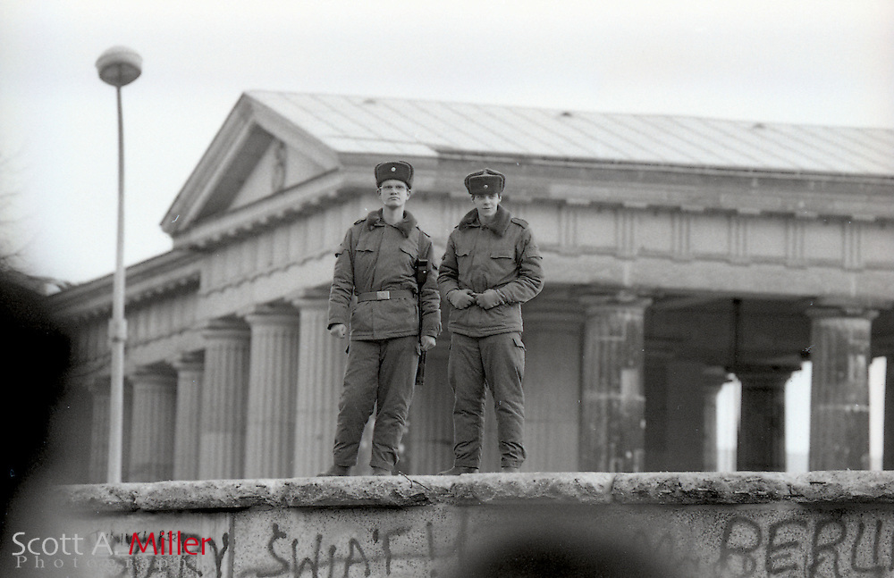 East German police patrol the Berlin Wall near the Brandenberger Tor (Brandenburg Gate). on Nov. 20, 1989. After the first few days of the border being open, the East Germans routinely patrolled the west side of the Berlin Wall, which actually sat inside of East Berlin, to keep people from damaging it. The borders between East and West Germany had been opened Nov. 9, 1989 for the first time in nearly 40 years.<br /> <br /> &copy;Scott A. Miller