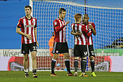 Brentford Ryan Woods (15) and Brentford Kamo Mokotjo (12) hug after their 1-0 win today during the EFL Sky Bet Championship match between Reading and Brentford at the Madejski Stadium, Reading, England on 20 January 2018. Photo by Gary Learmonth.