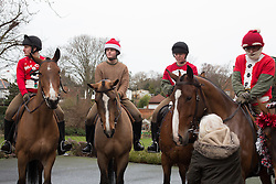 © Licensed to London News Pictures. 24/12/2016. The King's Troop Royal Horse Artillery have dressed up in Christmas outfits for their traditional Christmas eve trot through south east London. Based in Woolwich, the Troop trotted to Blackheath where locals patted the horses and enjoyed mince pies and sherry. Credit: Rob Powell/LNP
