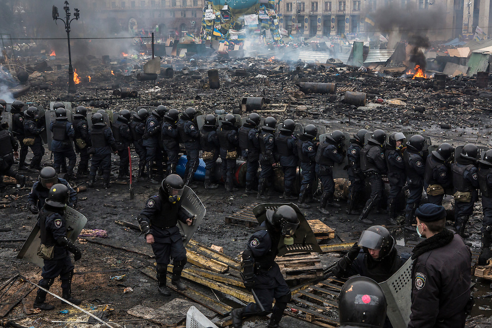 KIEV, UKRAINE - FEBRUARY 19: Police form a barrier in Independence Square on February 19, 2014 in Kiev, Ukraine. After several weeks of calm, violence has again flared between anti-government protesters and police as the Ukrainian parliament is meant to take up the question of whether to revert to the country's 2004 constitution. (Photo by Brendan Hoffman/Getty Images) *** Local Caption ***