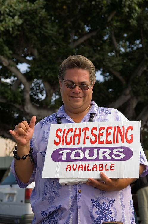 Tour guide Kalani with Golden Ilima Tours at pier for arrival of cruise ship; Kailua-Kona, Island of Hawaii..#0604547