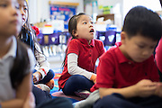 Melissa Nguyen reacts to a story read by teacher Wendy Lundeen in the transitional kindergarten class at Rose Elementary School in Milpitas, California, on April 5, 2013. (Stan Olszewski/SOSKIphoto)