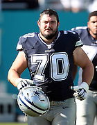 Dallas Cowboys guard Zack Martin (70) jogs down the sideline to start the second half during the 2015 week 11 regular season NFL football game against the Miami Dolphins on Sunday, Nov. 22, 2015 in Miami Gardens, Fla. The Cowboys won the game 24-14. (©Paul Anthony Spinelli)