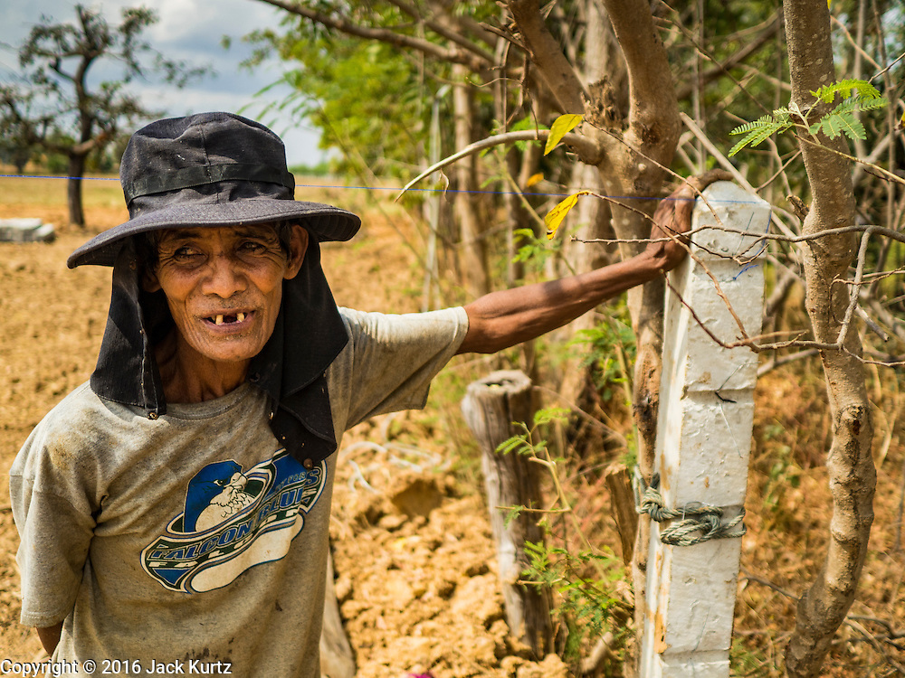 19 JANUARY 2016 - SI LIAM, BURI RAM, THAILAND: A farmer in Si Liam. He said he has lived in the community for more than 50 years and can't remember it ever being so dry. The drought gripping Thailand was not broken during the rainy season. Because of the Pacific El Nino weather pattern, the rainy season was lighter than usual and many communities in Thailand, especially in northeastern and central Thailand, are still in drought like conditions. Some communities, like Si Liam, in Buri Ram, are running out of water for domestic consumption and residents are traveling miles every day to get water or they buy to from water trucks that occasionally come to the community. The Thai government has told farmers that can't plant a second rice crop (Thai farmers usually get two rice crops a year from their paddies). The government is also considering diverting water from the Mekong and Salaween Rivers, on Thailand's borders to meet domestic needs but Thailand's downstream neighbors object to that because it could leave them short of water.        PHOTO BY JACK KURTZ