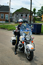 14 May 2014. New Orleans, Lousiana. <br /> A Sheriff motorcycle outrider at the Funeral for teenage shooting victim Miqual Jackson at the New Hope Baptist Church. 14 years old Jackson was shot in the back of the head May 5th and died shortly afterwards. His 15 year old brother  Lamichael was hit in the leg and survived. 52 year old Gregory Johnson is wanted on 1st degree murder charges. Randy Pittman, 49, an associate of Johnson's was arrested on 3 counts of being a principal to 1st degree murder. The New Hope Baptist Church witnessed the funeral of 1 year old Londyn Samuels who was also gunned down in cold blood on the streets of New Orleans 8 months ago.<br /> Charlie Varley/varleypix.com