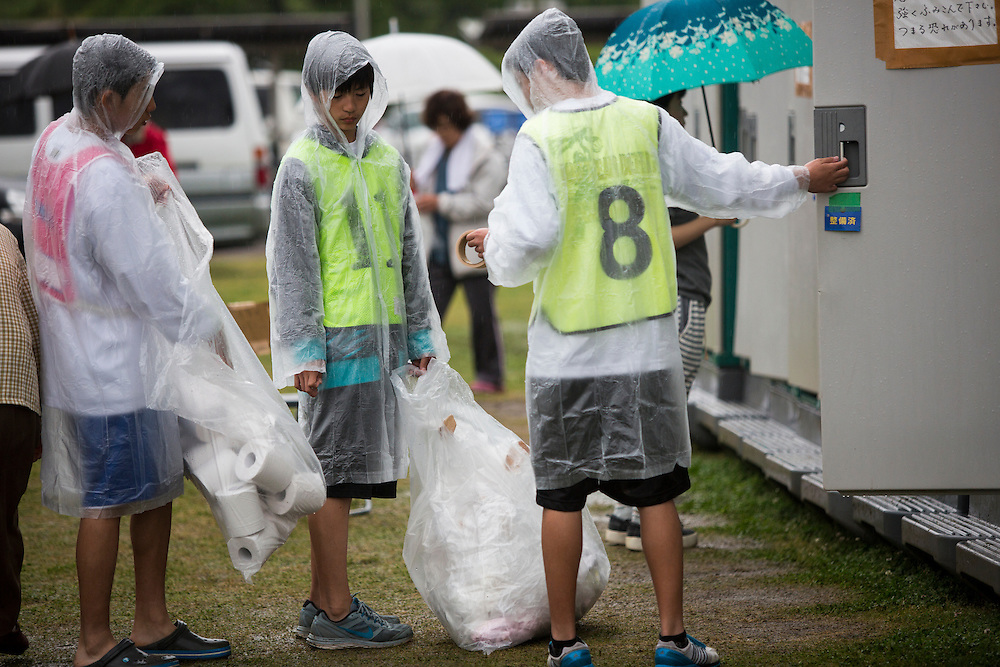 KUMAMOTO, JAPAN - APRIL 21:  Young volunteers help cleaning toilets in the morning of April 21, 2016 in Mashiki Gymnasium parking area, Kumamoto, Japan. To date 45 people are confirmed dead and around 11,000 people have evacuated after an 6.5 earthquake on Thursday night and a stronger 7.3 quake on Saturday morning struck the Kyushu Island in western Japan.<br /> <br /> Photo: Richard Atrero de Guzman