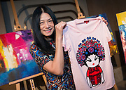 Chinese Designer Vivienne Tam with her Opera Girl T-shirt for sale for charity. The Womens Foundation Annual Gala Charity ball at the Harbourside Hotel Wan Chai<br />