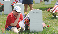 Jeanette Poston cries at the graveside of her son Zachary R. Wobler Monday afternoon at Arlington Cemetary during the 142nd Memorial Day Observance. Staff Sergent Zachary R. Wobles, 24, of Ohio died February 6, 2005 in Mosul Iraq, when his dismounted patrol encountered enemy forces. Wobler was assigned to the Army's 2nd Battalion, 325th Airborne Regiment, 82nd Airborne Division, Fort Bragg, North Carolina. (photo by Dana Rene Bowler)