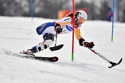 JOCHEMSEN Anna LW2 NED competing in the ParaSkiAlpin, Para Alpine Skiing, Slalom at the PyeongChang2018 Winter Paralympic Games, South Korea.