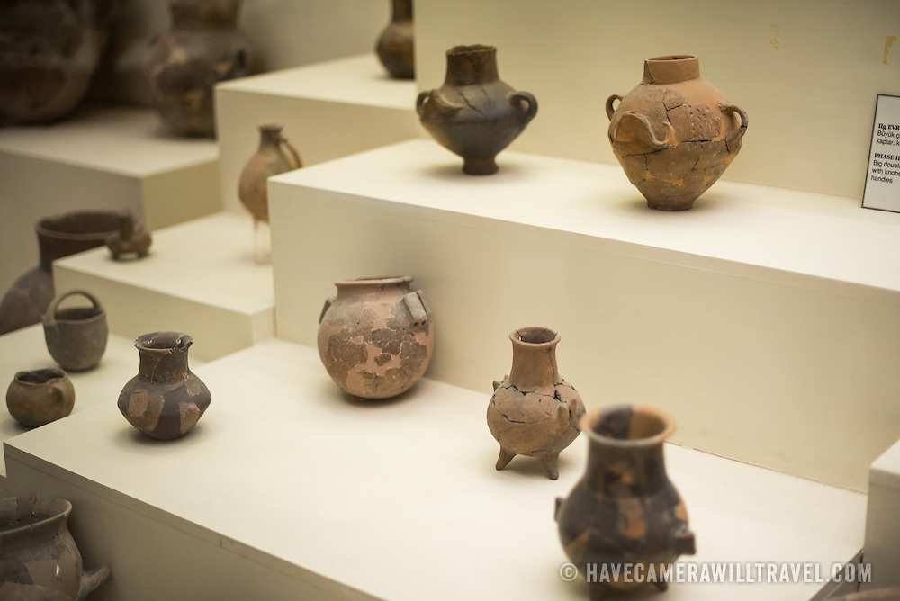 Exhibit displaying artefacts from the 2nd  settlement of Turkey (2500-2300 BC) on display in the main building of the Istanbul Archaeology Museums. The Istanbul Archaeology Museums, housed in three buildings in what was originally the gardens of the Topkapi Palace in Istanbul, Turkey, holds over 1 million artifacts relating to Islamic art, historical archeology of the Middle East and Europe (as well as Turkey), and a building devoted to the ancient orient.