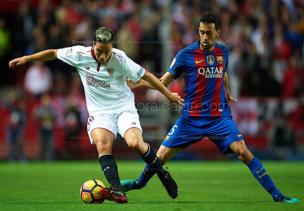 SEVILLE, SPAIN - NOVEMBER 06:  Samir Nasri of Sevilla FC (L) being followed by Sergio Busquets of FC Barcelona (R) during the match between Sevilla FC vs FC Barcelona as part of La Liga at Ramon Sanchez Pizjuan Stadium on November 6, 2016 in Seville, Spain.  (Photo by Aitor Alcalde/Getty Images)