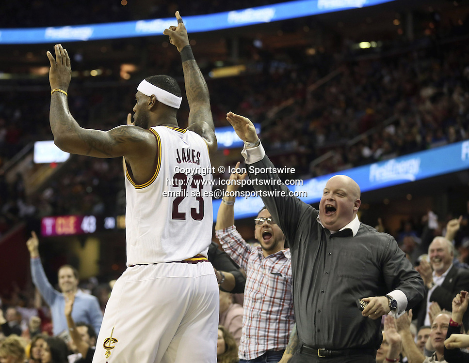 Feb. 11, 2015 - Cleveland, OH, USA - Fans in the front row look to slap hands with the Cleveland Cavaliers' LeBron James on his way to shoot a free throw after being fouled in the second quarter against the Miami Heat at Quicken Loans Arena in Cleveland on Wednesday, Feb. 11, 2015