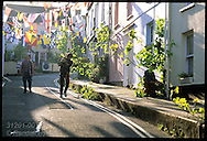 Men decorate town with sycamore branches the evening before May Day festival in Padstow; Cornwall, England.