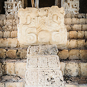 """Carved decorations at the bottom of the stairs of the Acropolis on the northern side of the Ek'Balam archeological site on Mexico's Yucatan Peninsula. It was once a thriving city of Maya Civilization dating to the Late Classic period. It is 30km north of Valladolid and is named for """"Black Jaguar"""" a distinctive motif throughout the site."""