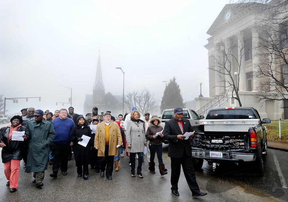 Photo by Gary Cosby Jr.  Marchers circle the Limestone County Courthouse Monday as part of the commemoration of Martin Luther King Jr. Day in Athens.