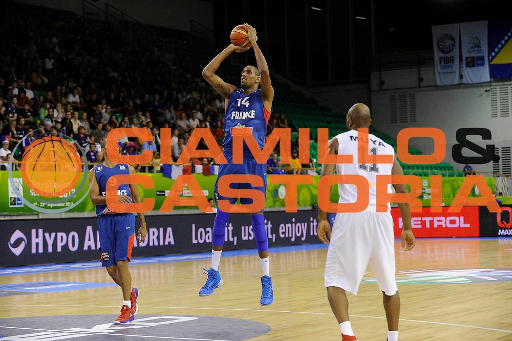 DESCRIZIONE : Lubiana Ljubliana Slovenia Eurobasket Men 2013 Preliminary Round Belgio Francia Belgium France<br /> GIOCATORE : Alexis Ajinca<br /> CATEGORIA : tiro shot<br /> SQUADRA : Francia France<br /> EVENTO : Eurobasket Men 2013<br /> GARA : Belgio Francia Belgium France<br /> DATA : 09/09/2013 <br /> SPORT : Pallacanestro <br /> AUTORE : Agenzia Ciamillo-Castoria/H.Bellenger<br /> Galleria : Eurobasket Men 2013<br /> Fotonotizia : Lubiana Ljubliana Slovenia Eurobasket Men 2013 Preliminary Round Belgio Francia Belgium France<br /> Predefinita :