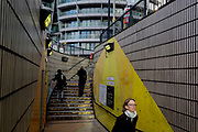 With new apartment architecture above them, Londoners use the underpass steps leading into the Old Street station in Shoreditch, on 5th November 2019, in London, England.