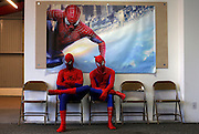 "Peter Norbot (L) and Kris Hamilton, dressed up as fictional comic book superhero Spider-Man, wait for their turn to audition to be a part of a promotional campaign for the upcoming release of the new movie ""The Amazing Spider-Man 2"" in Chicago March 19, 2014.   REUTERS/Jim Young"