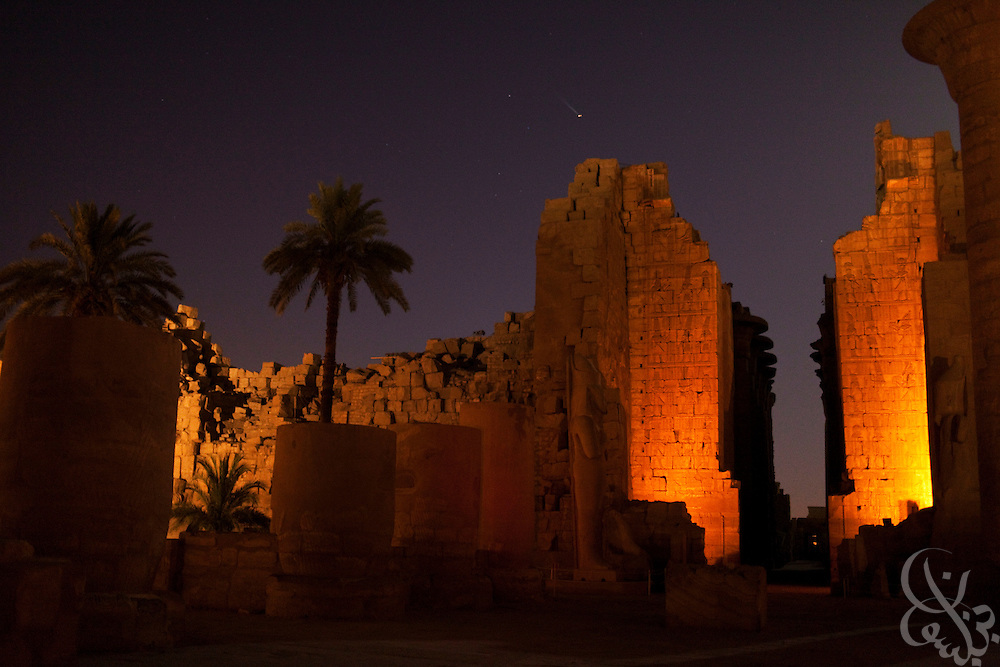 The palace complex at Karnak is illuminated by colored lights as part of a tourist sound and light show June 6, 2009 near Luxor, Egypt. Local officials have embarked on a 30 year redevelopment plan in Luxor and the surrounding area that will cost an estimated total of 5 billion Egyptian pounds (nearly 200 million US dollars.) The plan calls for redevelopment of local infrastructure and improved access access and increased protection of the areas famed ancient archeological marvels. (Photo by Scott Nelson, for the Times)