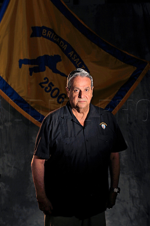 "FELIX RODRIGUEZ, 69<br /> Infiltration team<br /> From his safe house inside Cuba, Felix Rodriguez remembers the shock at seeing <br /> television reports of the the camouflaged Bay of Pigs invaders being rounded up, <br /> hands behind their heads.<br /> Rodriguez, the current president of Assault Brigade 2506, had been smuggled into <br /> Cuba weeks earlier and had been supplying the underground movement with arms and <br /> equipment -- waiting for orders to join the fight to topple Fidel Castro's <br /> government soon after the invasion was launched.<br />  ""The Americans never informed us the invasion was on its way; I was caught by <br /> surprise,'' he said. Instead, Rodriguez said Castro launched a massive crackdown <br /> across the country.<br />  ""They began rounding up everybody suspected of being part of the opposition. <br /> There were as many as 100,000 activists held in sports stadiums and inside the <br /> famous Blanquita Theater.''<br />  Rodriguez found himself trapped with no way out of Cuba.<br />  ""I would call people on the phone who had been working with me and no one would <br /> answer. Or someone would answer and encourage me to come right over -- a trap.''<br />  After several tense days, a Cuban woman working with the Brigade infiltrators <br /> helped him get to the Venezuelan embassy in Havana, where he sought political <br /> asylum. ""If it wasn't for her, I would have been caught and killed,'' he said.<br />  ""The invasion was a total disaster.''Bay of Pigs veteran,  Felix Rodriguez poses at the Bay of Pigs Museum in Little Havana. He is a member of the Bay of Pigs Veterans Association, Brigade 2506"
