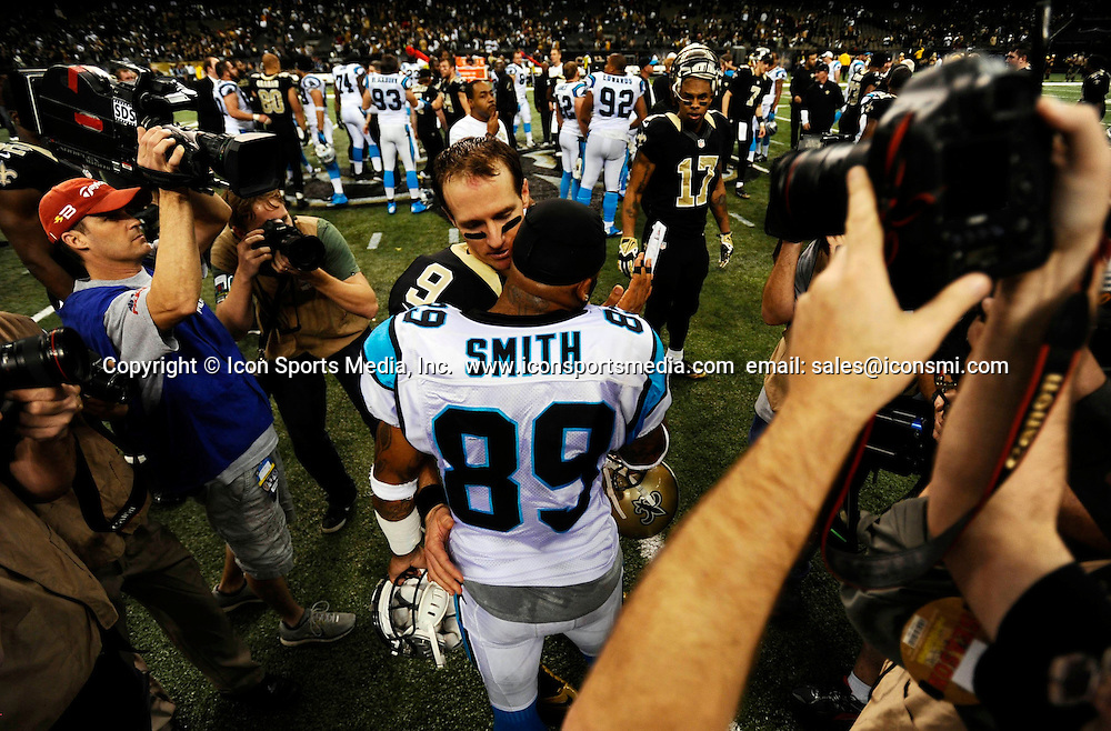 Dec. 8, 2013 - New Orleans, LA, USA - New Orleans Saints' Drew Brees (9) talks with Carolina Panthers' Steve Smith (89) after their game at the Mercedes-Benz Superdome in New Orleans on Sunday, Dec. 8, 2013