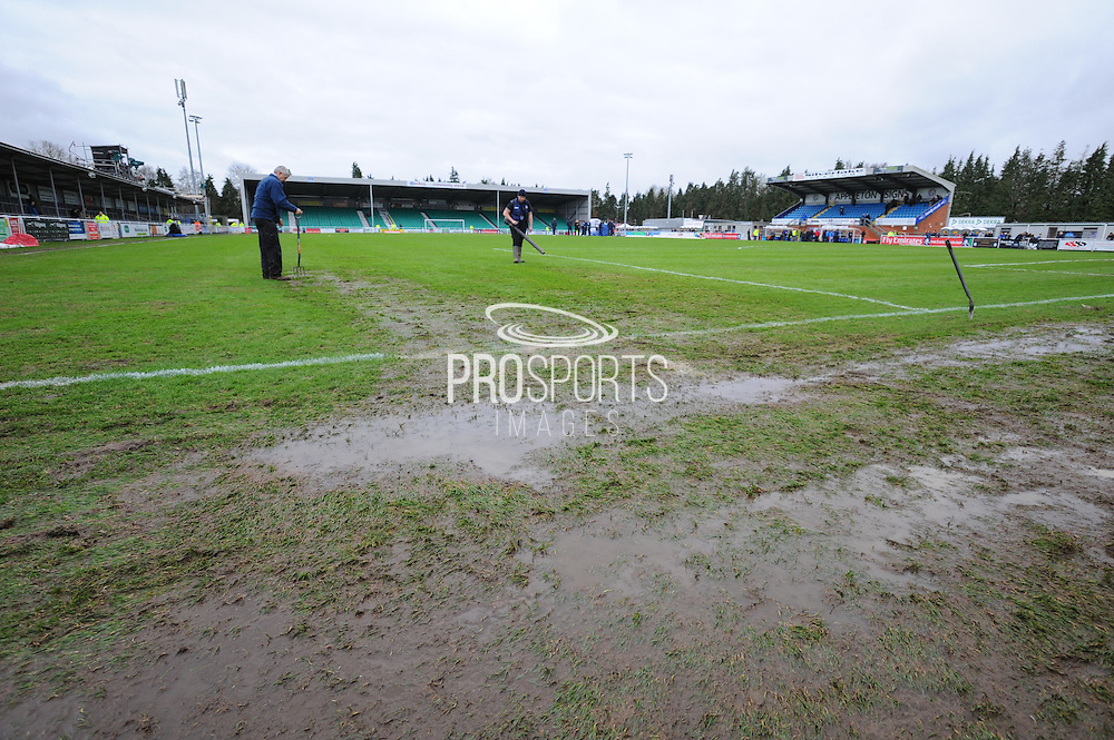 The groundsmen working on the wet parts of the pitch before the The FA Cup third round match between Eastleigh and Bolton Wanderers at Silverlake Stadium, Ten Acres, Eastleigh, United Kingdom on 9 January 2016. Photo by Graham Hunt.
