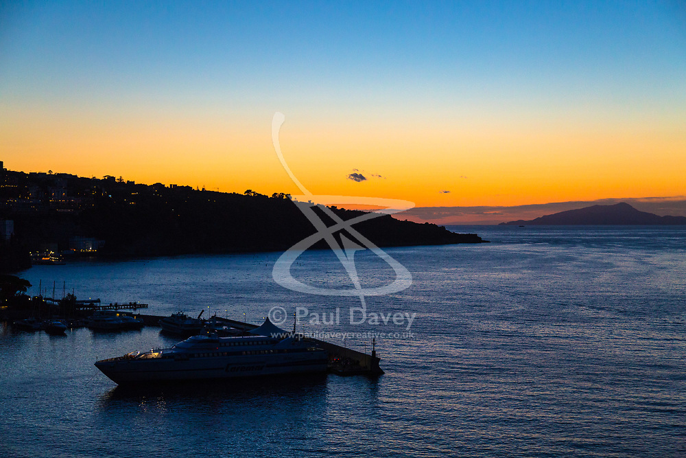 Sorrento, Italy, September 18 2017. The afterglow of sunset creates a restful scene as a ferry docks in Sorrento, Italy. © Paul Davey
