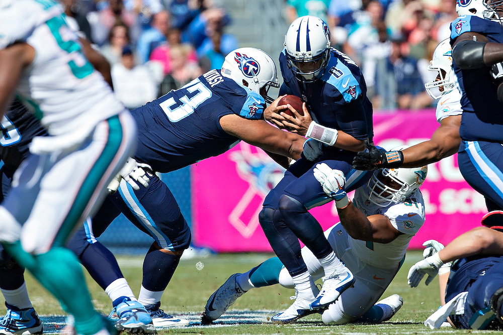 NASHVILLE, TN - OCTOBER 18:  Marcus Mariota #8 of the Tennessee Titans is sacked by Cameron Wake #91 of the Miami Dolphins at LP Field on October 18, 2015 in Nashville, Tennessee.  The Dolphins defeated the Titans 38-10.  (Photo by Wesley Hitt/Getty Images) *** Local Caption *** Marcus Mariota; Cameron Wake
