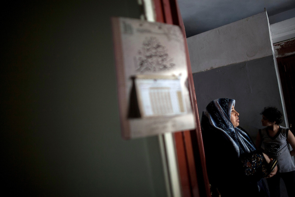 06/27/2013 Tariq al-Jdeideh, Beirut, Lebanon: A Syrian woman who fled Damascus at the entrance to her one-bedroom apartment, which she shares with 2 families. Estimates have placed the number of Syrian refugees in Lebanon at well over 500,000 people.