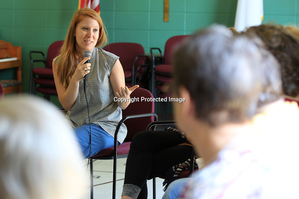 """Cassie Meador, Director of The Dance Exchange, talks with residents at Traceway Retirement Center about preparing for a dance piece that will be presented on Saturday Febuary 10, 2018, as they centerpiece of a multi-arts showcase entitled """"Journey"""" that will cap off the 2018 Link Centre Artist Residency program. Meador was joined by Roxie Thomas Clayon and the Doniphan Dance Project members to assist in teaching."""