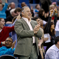 December 17, 2010; New Orleans, LA, USA; New Orleans Hornets minority owner Gary Chouest applauds after a guard Marcus Thornton (not pictured) dunk during the second half of a game against the Utah Jazz at the New Orleans Arena.  The Hornets defeated the Jazz 100-71. Mandatory Credit: Derick E. Hingle